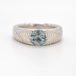 Mokume Labyrinth Engagement Ring in Ash with Montana Sapphire