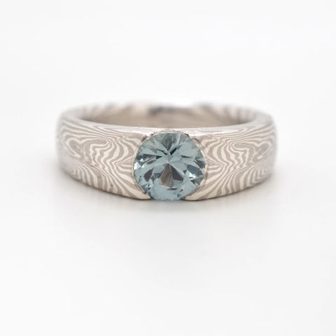 Mokume Engagement Ring in Silver and Palladium with cathedral set blue green Montana sapphire