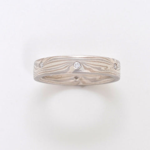 Three color white mokume gane ring with flush set diamonds