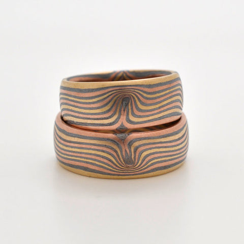 Matched Wedding Set in 14k Red Gold, 14k Yellow Gold and Sterling Silver Mokume Gane with etched finish