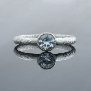 Mokume Gane Engagement Ring Ash Palette and Sky Blue Topaz