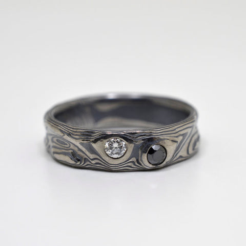 Mokume Guri Bori Ring in Oxidized Ash with Black & White Diamonds