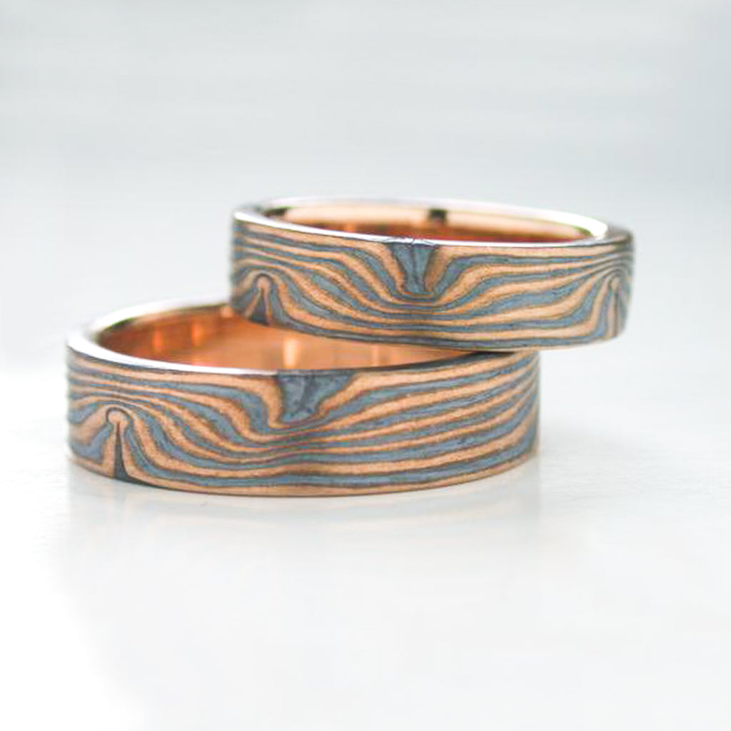 mokume gane matched wedding ring set in red gold and oxidized silver