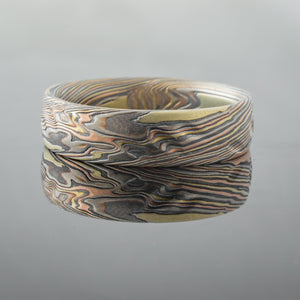 red gold, silver, yellow gold bespoke ring . mokume gane