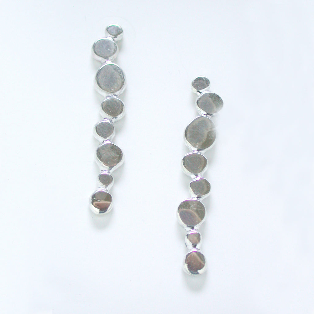 "Minimal and organic, these posted ""pebble"" earrings are great for evening or daytime wear. Pictured in polished sterling silver."