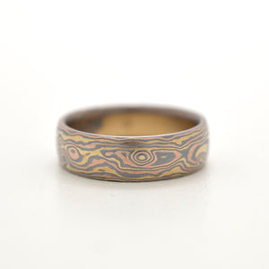 custom mokume gane wedding ring in yellow gold, red gold and oxidized silver