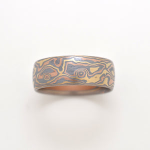 mokume gane wedding ring in yellow gold, red gold, and oxidized silver