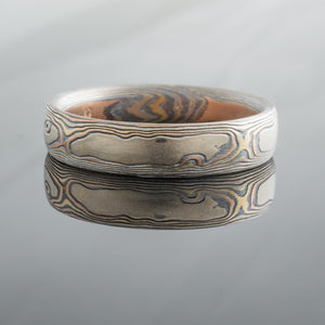 woodgrain pattern mokume ring with red gold and silver. Rustic