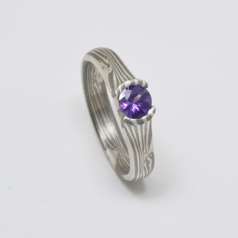 Mokume Engagement Ring in Palladium and Silver with a round purple sapphire