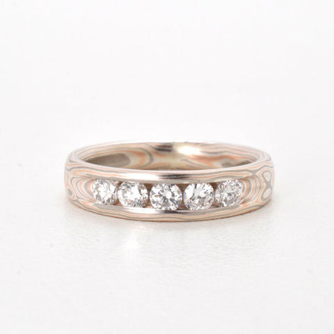 Tapered Mokume Gane band with Channel Set Diamonds in 14k Red Gold, Palladium, and Sterling Silver with Satin Finish