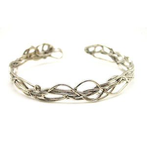 Inspired by New England vines and branches, this twist bracelet is a one of a kind statement.  Organic and ephemeral. Pictured in sterling silver. Also available in vermeil or oxidized silver.