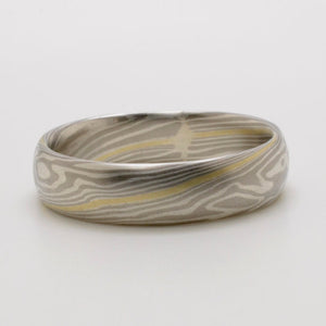 Mokume Twist Wedding Band in Ash with Arns Yellow Gold Stratum