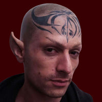 man wearing foam latex prosthetic ears