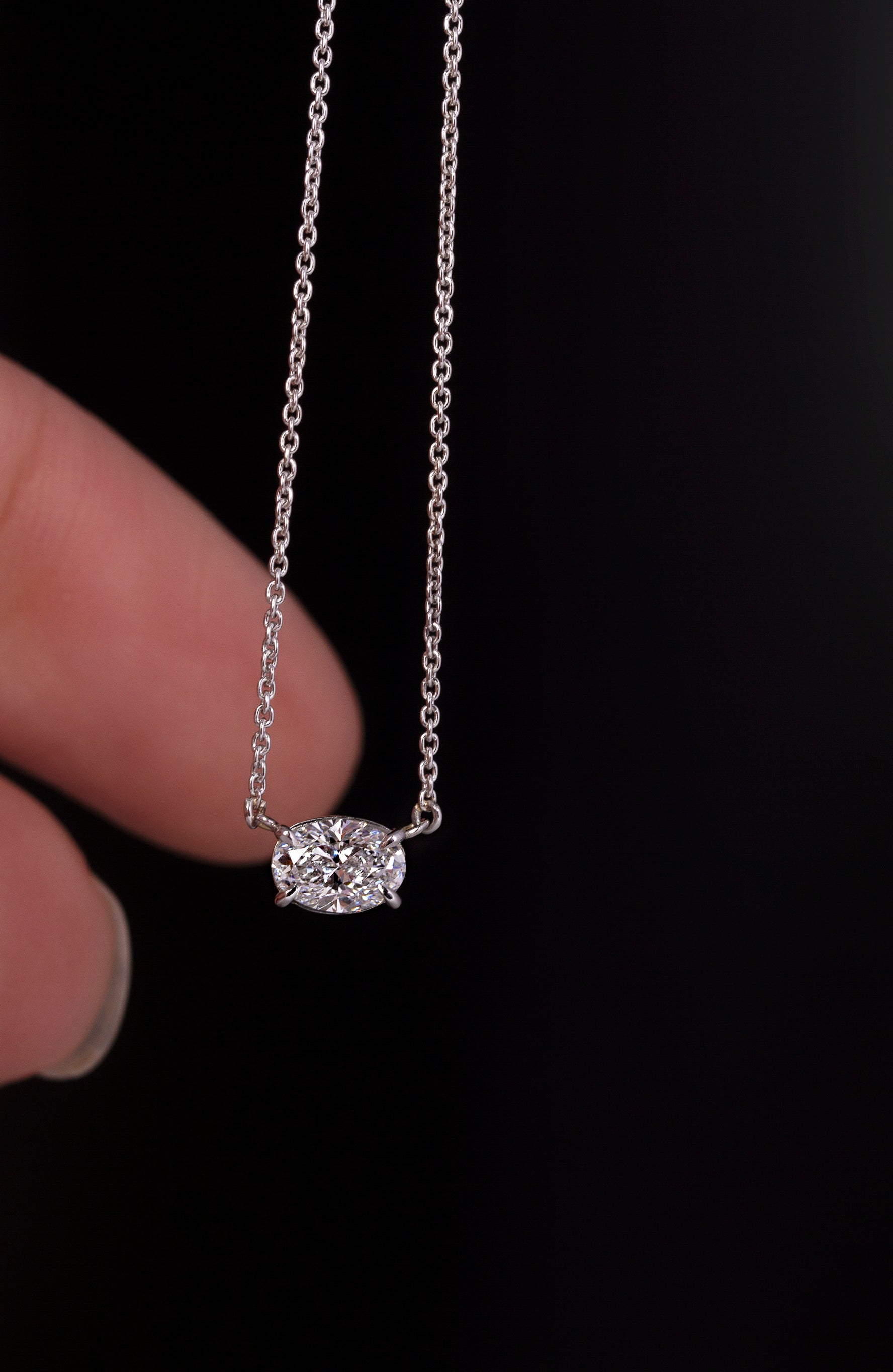Platinum Oval Diamond pendent in an East-West setting