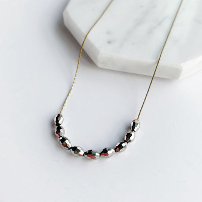 Basaltic Necklace – Brass
