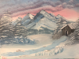 Winter scene with mountains and cabin.