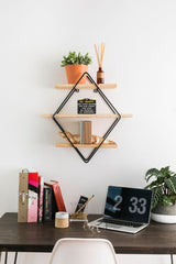 Tidy desk with floating wall shelf hanging above desk for office supplies and books