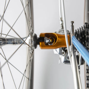 Replace your rear wheel's axle nut with the stainless Hogg nut and then you can screw on the Hogg body when you're ready to transport your bike. Your front wheel's quick-release skewer clamps onto the Hogg body and off you go!