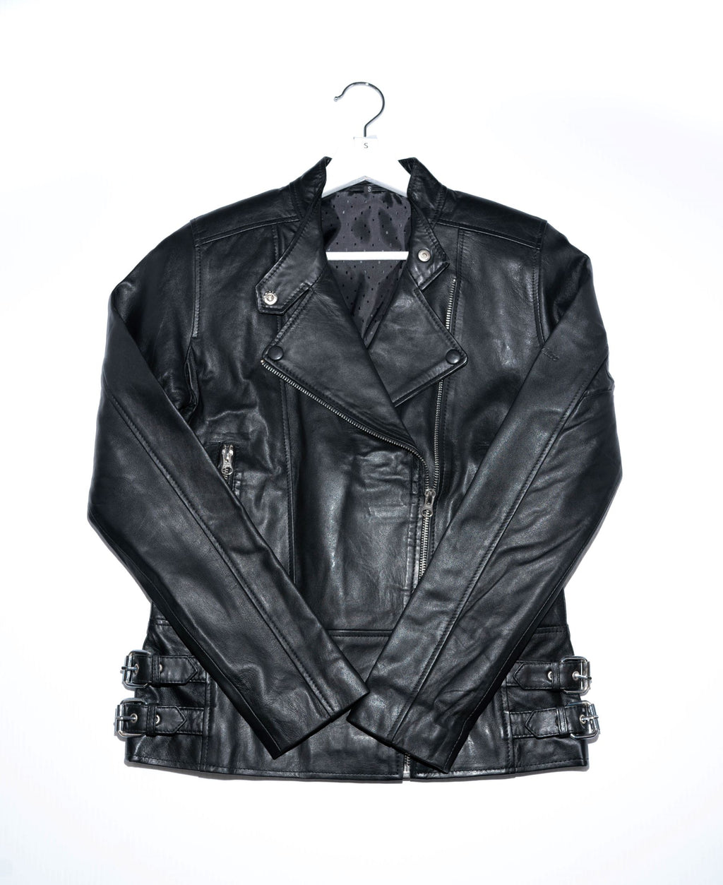 This premium leather jacket has a slim, and feminine fit. It's cut from naked leather made in India that's been hand selected for a luxurious look and feel. This jacket has an asymmetric closure and exposed hardware.