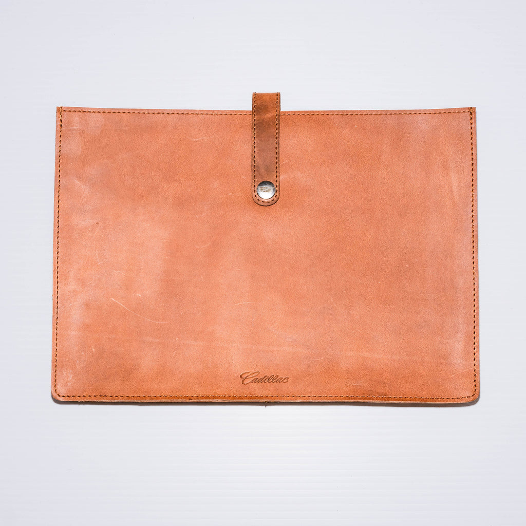 "This laptop sleeve made of premium Buffalo leather acts as a document holder while holding up to a 14.5"" laptop."