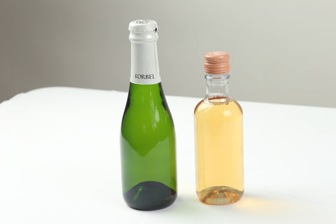 Two mini wine bottles ready for a new label