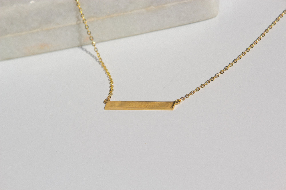 Load image into Gallery viewer, Custom engraved bar name necklace mejuri, engraved bar necklace gold mejuri, buy engraved bar necklace toronto, toronto bar necklace cheap, affordable gold engraved bar necklace toronto
