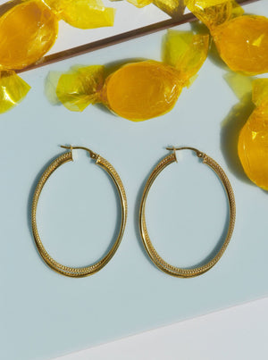 mejuri, oval gold hoop earrings, oval diamond cut gold hoops, 10k gold hoops affordable, buy cheap gold oval hoops