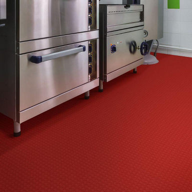 Perfection Floor Tile Vinyl Coin Tiles in Red Shown in Context of a Commercial Kitchen