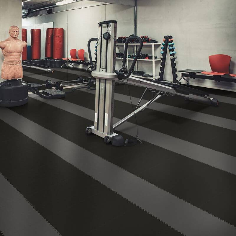 "Perfection Floor Tile Duro-Gym Vinyl Smooth Tiles - 7mm Thick (20.5"" x 20.5"") Shown in the Context of a Home Gym with Stripe Pattern"