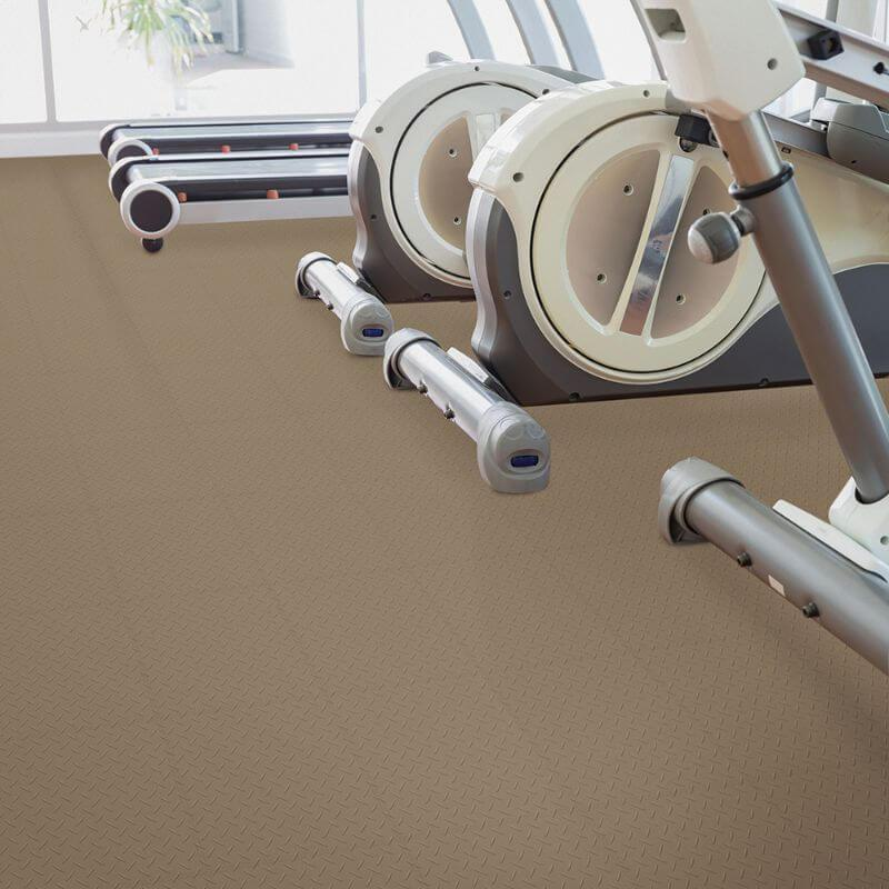 Perfection Floor Tile Vinyl Diamond Tiles in Beige Shown in Context of a Home Gym