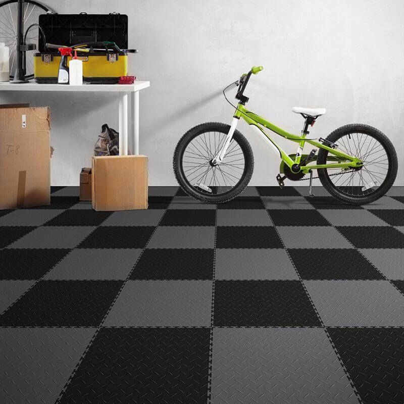 Perfection Floor Tile Vinyl Diamond Tiles in Dark Gray Shown in Context of a Garage