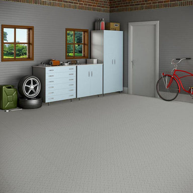 Perfection Floor Tile Vinyl Diamond Tiles in Light Gray Shown in Context of a Garage