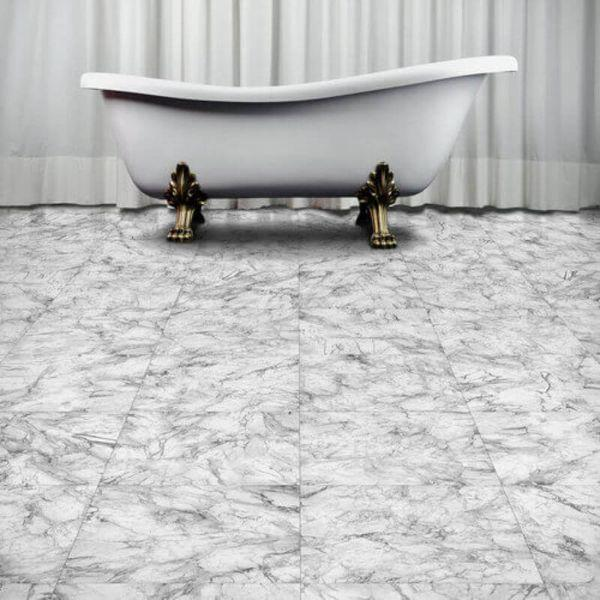 "Perfection Floor Tile Marble Luxury Vinyl Tiles - 5mm Thick (20"" x 20"") with White Marble Pattern Being Used in a Bathroom"