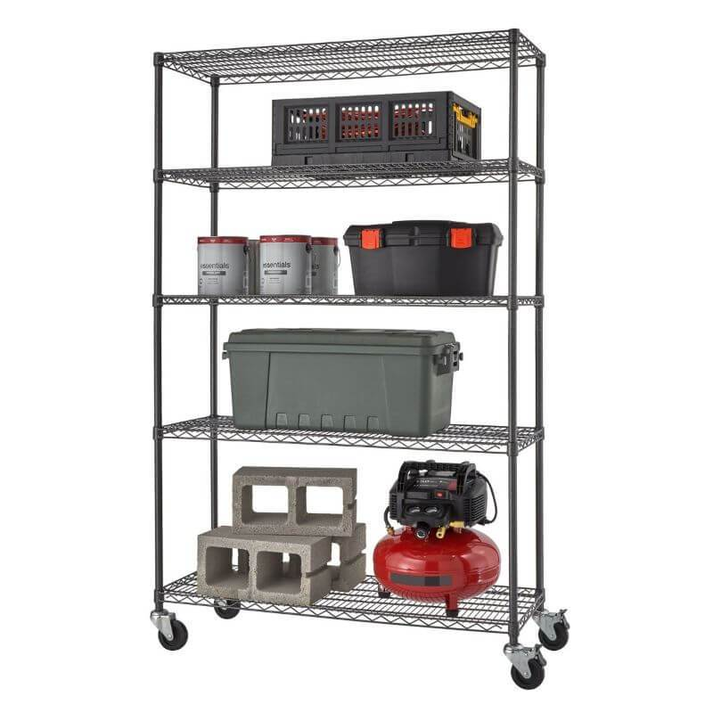 Trinity TBFPBA-0924 (48x18x72) PRO 5-Tier Wire Shelving w/ Wheels in Black Anthracite Color. Shown with common garage, tools and contruction equipment. View from the front right.