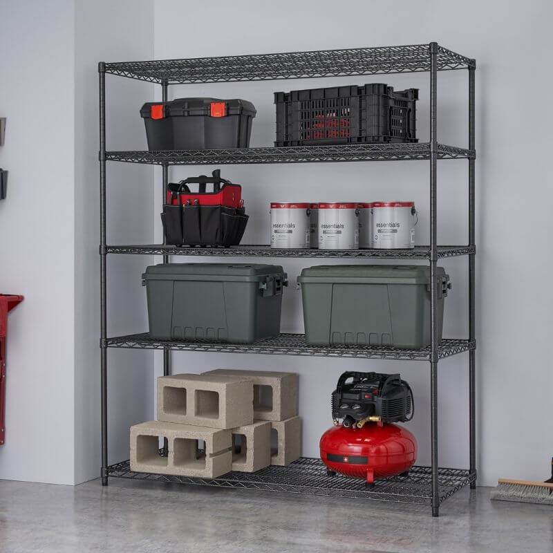 Trinity TBFPBA-0928 (60x24x72) PRO 5-Tier Wire Shelving in Black Anthracite Color Shown with Some Building and Construction Supplies viewed from the Front Right.