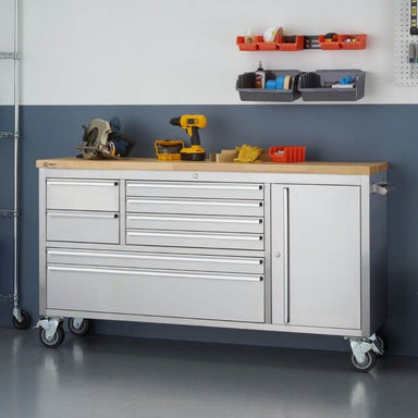 Trinity TLS-4813 (66x19) Stainless Steel Rolling Workbench with Worktop Being Used. Viewed from the Front Right and shown next to a wall.