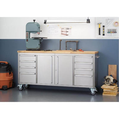 Trinity TLS-7204 (72x19) Stainless Steel Rolling Workbench Against a Wall. Worktop is being used for renovation tools.