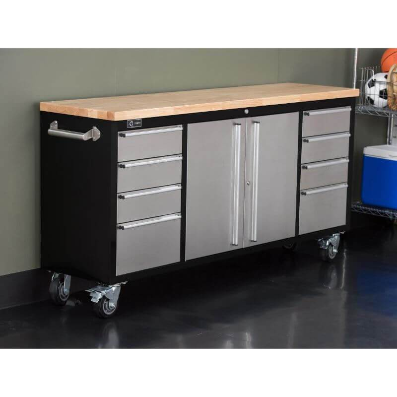 Trinity TLS-7205 (72x19) Black & Stainless Steel Rolling Workbench with all drawers closed. Placed against a wall.