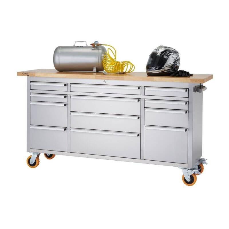 Trinity TLSF-7209 (72x19) PRO Stainless Steel Rolling Workbench Shown with an Air Compressor and Motorcycle Helmet on the Worktop. Viewed from front right and with a white background.