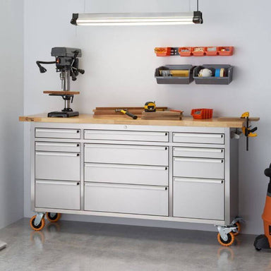 Trinity TLSF-7209 (72x19) PRO Stainless Steel Rolling Workbench Shown with Some Workshop Tools & Equipment on the Worktop. Viewed from front right and placed next to a wall.