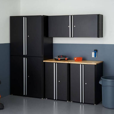 Trinity TLSPBK-0613 (6-Piece) Garage Cabinet Set in Black Placed Against a Wall in a Garage.