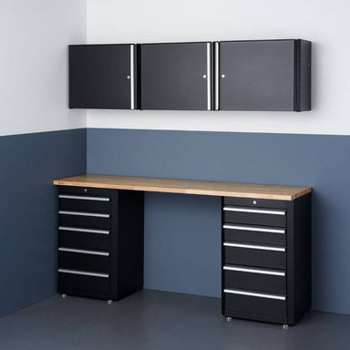 Trinity TLSPBK-0617 (6-Piece) Garage Drawer Set In Black Placed Against a Wall in a Garage.