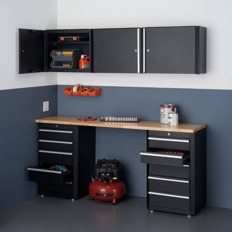 Trinity TLSPBK-0617 (6-Piece) Garage Drawer Set In Black Placed Against a Wall in a Garage With Some Cabinets and Drawers Opened.