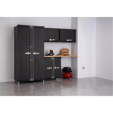 Trinity TSNPBK-0616 (5-Piece) PRO Garage Cabinet Set in Black Placed Against a Wall with Drawers Closed.