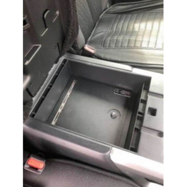 Locker Down LD2053EX vehicle console safe for Nissan Titan 2016-2020 viewed inside the car on top of center console safe.