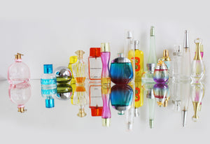 Variety of perfume bottles and reflections