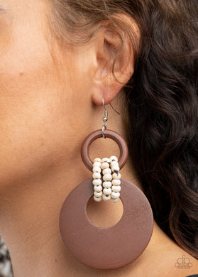 White wooden beaded links connect together a brown wooden ring and an oversized brown wooden crescent-like hoop, creating a uniquely earthy lure. Earring attaches to a standard fishhook fitting.  Sold as one pair of earrings.