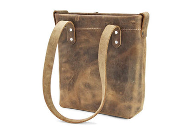 A distressed leather tote handbags