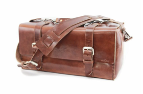 A small full grain leather duffle bag