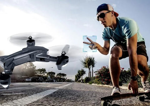 Man controlling drone with gesture